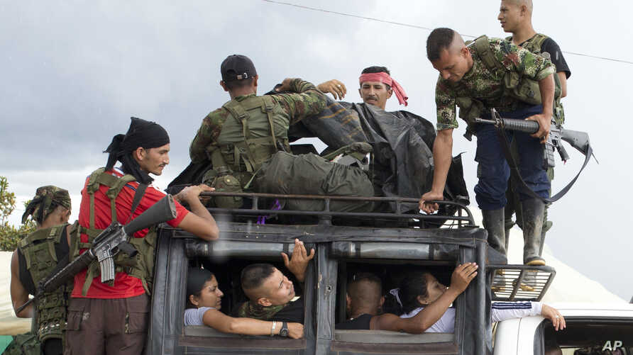 Rebels of the Revolutionary Armed Forces of Colombia, FARC, arrive in Yari Plains, southern Colombia, Sept. 25, 2016.