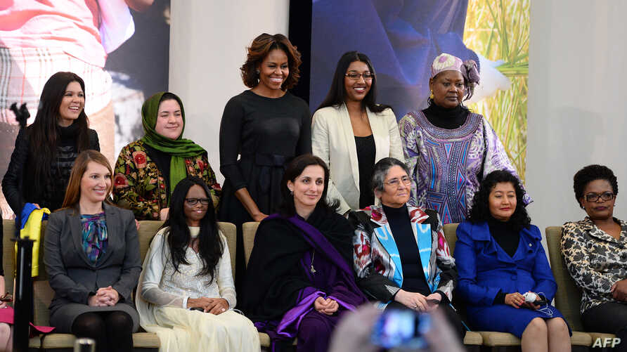 First Lady Michelle Obama, back row, center, poses with recipients of the Secretary of State's International Women of Courage Award, Washington, March 4, 2014.