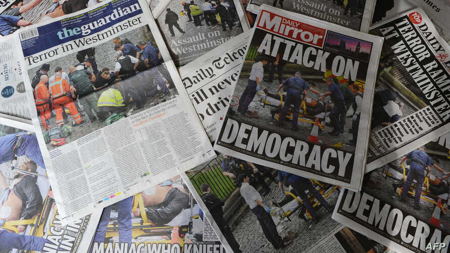 An arrangement of newspapers pictured in London on March 23, 2017, as an illustration, shows the front pages of the UK daily newspapers reporting on the March 22 terror attack.