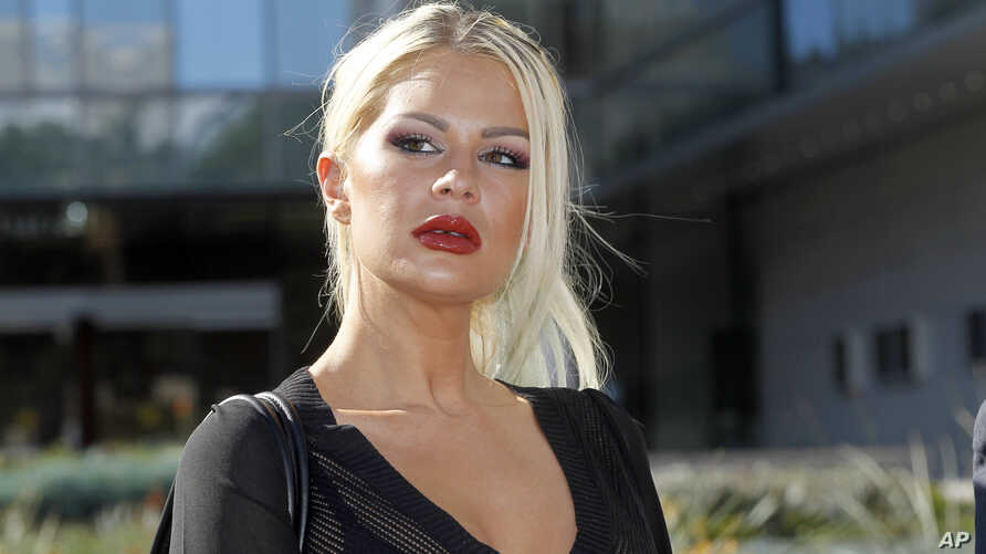 FILE - Chloe Goins, a model who claims entertainer Bill Cosby drugged and sexually abused her at the Playboy Mansion in 2008, appears before reporters outside Los Angeles police headquarters after meeting police investigators in Los Angeles, Jan. 14,