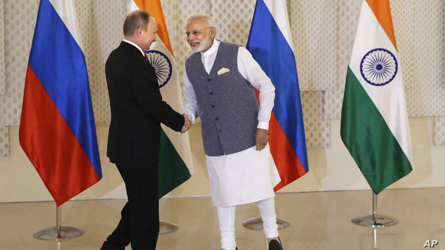 Indian Prime Minister Narendra Modi, right, shakes hand with Russian President Vladimir Putin prior to their bilateral meeting, in Goa, India, Oct. 15, 2016. The two leaders signed several agreements as part of apparent efforts aimed at rejuvenating