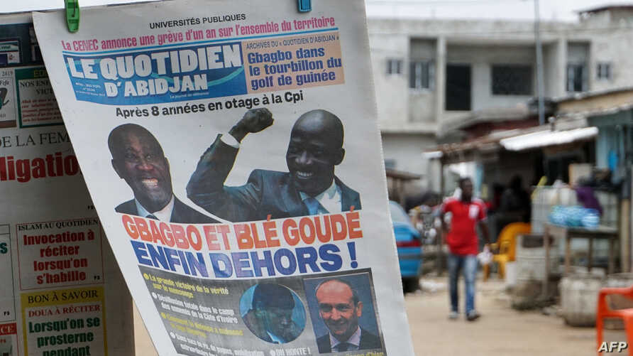 "FILE - A photo taken Feb. 2, 2019, in Abidjan's popular Yopougon district shows the front page of a newspaper, reading ""Gbagbo and Ble Goude finally out!"" a day after the International Criminal Court freed former Ivory Coast president Laurent Gbagbo"