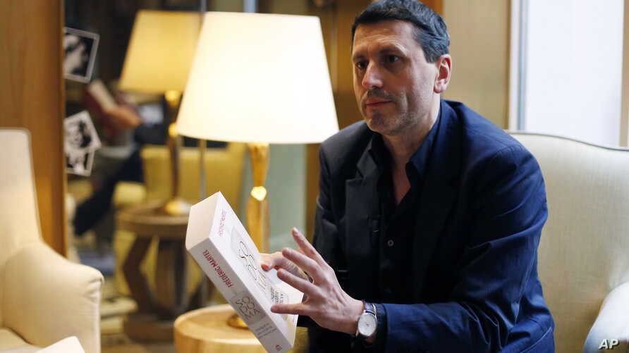 French writer Frederic Martel gestures during an interview with Associated Press, in Paris, Feb. 15, 2019.