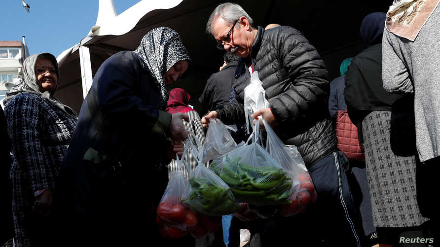 People shop at a tent set up by the municipality in the Bayrampasa district of Istanbul, Turkey, Feb. 11, 2019.