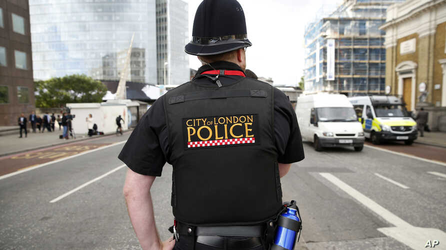 A police officer patrols the street in the London Bridge area of London, June 5, 2017.