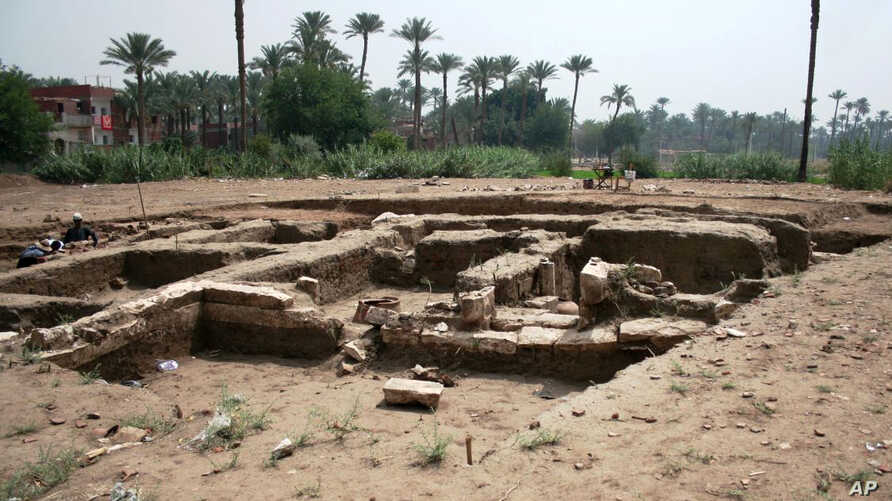 This undated photo released by the Egyptian Ministry of Antiquities, shows a large Roman bath and a chamber likely for religious rituals, that was recently discovered in the town of Mit Rahina, 20 kilometers, or 12 miles, south of Cairo, Egypt.