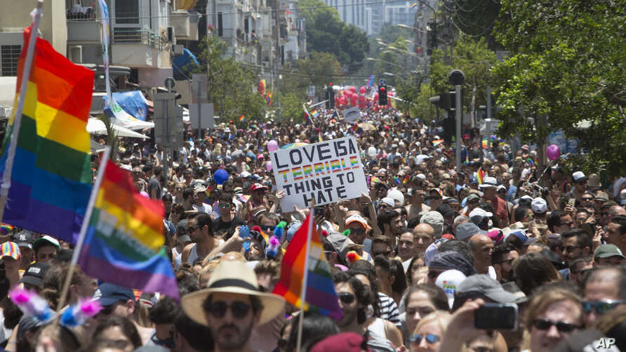 Israelis and tourists march during the Gay Pride Parade in Tel Aviv Israel, June 9, 2017. About 200,000 people from the LGBT community in Israel and abroad attended in Tel Aviv's annual gay pride parade.