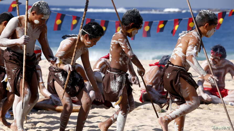 Traditonally dressed Australian Aboriginal performers participate in a 'Corroboree' showcasing traditional dance during an event to mark National Reconciliation Week on Sydney's Coogee Beach May 27, 2015.