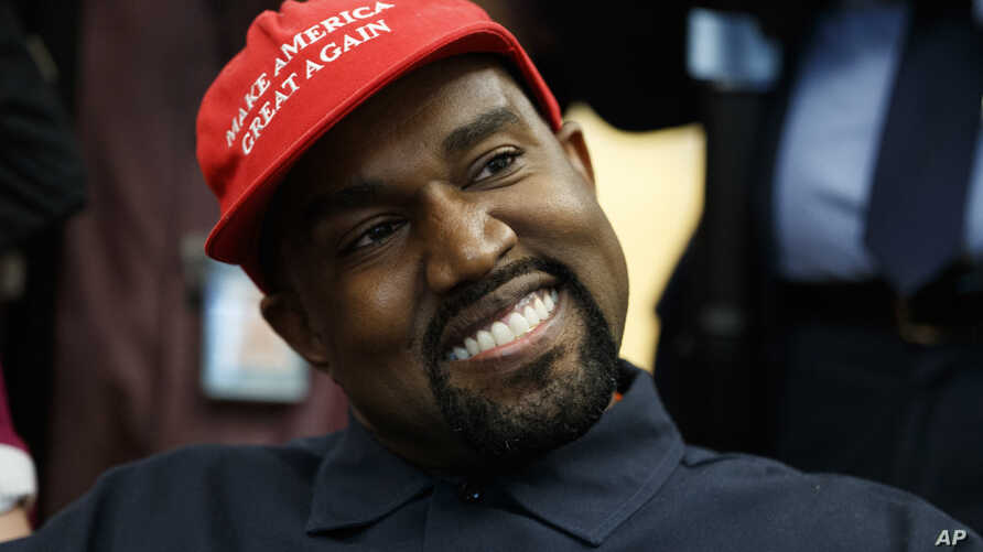 Rapper Kanye West smiles as he listens to a question from a reporter during a meeting in the Oval Office of the White House with President Donald Trump, Oct. 11, 2018, in Washington.