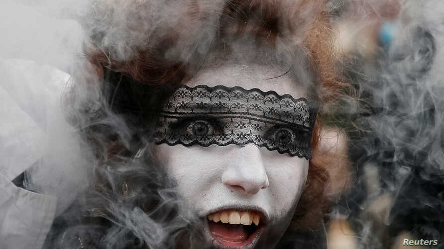 "A participant takes part in a ""Zombie Walk"" parade in Kiev, Ukraine, Oct. 28, 2017."