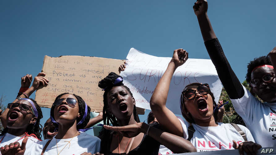 Kenyan women shout slogans as they participate in a feminist march in honor of International Women's Day in Nairobi, March 8, 2019.