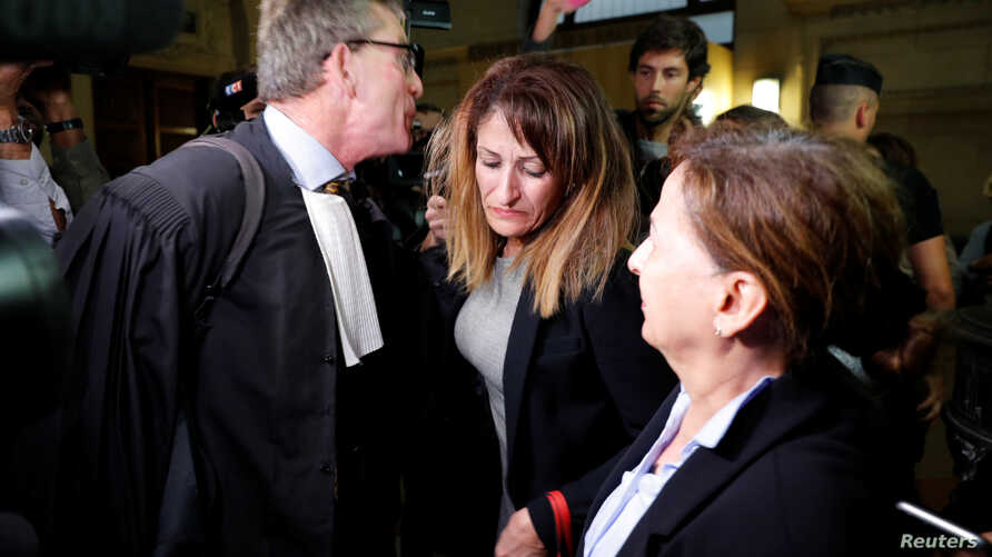 Nathalie Haddadi (C), whose radicalised son fought in Syria where he allegedly died as a jihadist, and her lawyer Herve Denis leave the criminal court in Paris, France, Sept. 28, 2017.