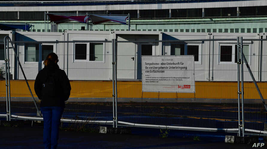 FILE - Temporary housing units for refugees are seen at the former Tempelhof airport in Berlin, Germany, Dec. 04, 2017.