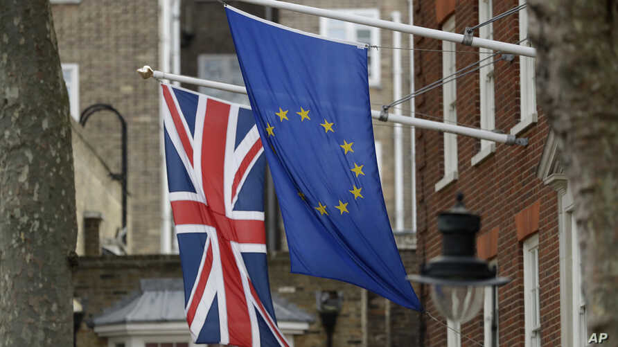 A European and British Union flags hang outside Europe House, the European Parliament's British offices, in London, Tuesday, March 14, 2017.
