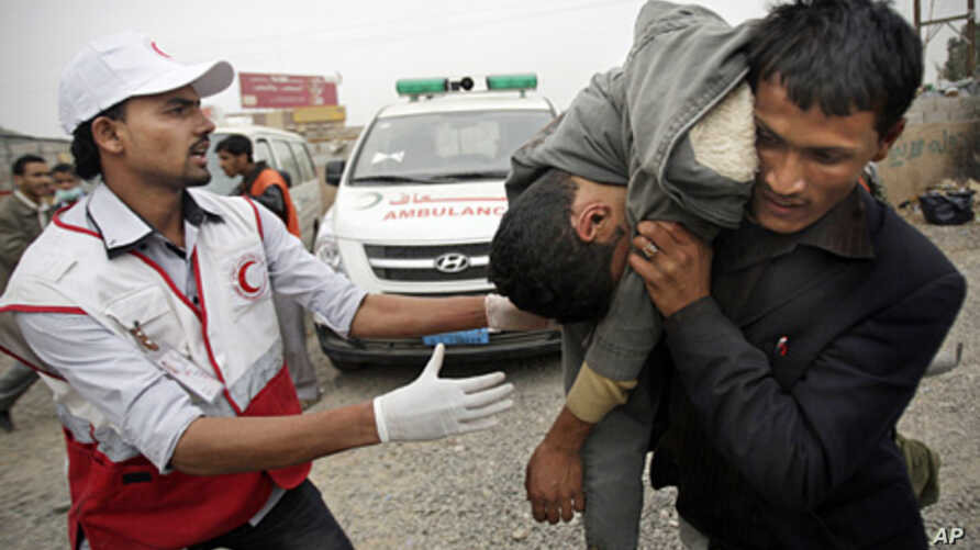 A man carries a wounded protester during clashes in Sana'a, Yemen,  Nov. 24, 2011.