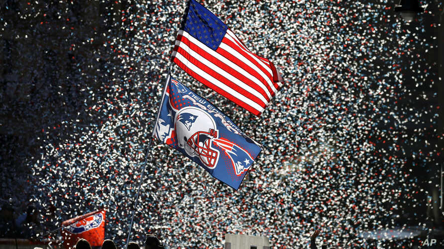 Confetti flies as fans watch the New England Patriots parade through downtown Boston, Feb. 5, 2019, to celebrate their win over the Los Angeles Rams in Sunday's NFL Super Bowl 53.