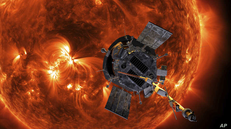This image made available by NASA shows an artist's rendering of the Parker Solar Probe approaching the Sun. It's designed to take solar punishment like never before, thanks to its revolutionary heat shield that's capable of withstanding 2,500 degree