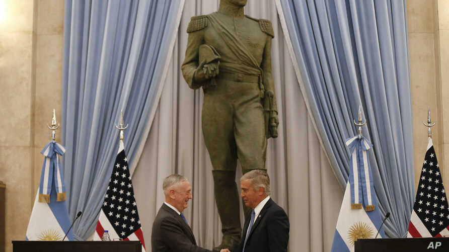 U.S. Secretary of Defense Jim Mattis, left, and Argentina's Defense Minister Oscar Raul Aguad shake hands in Buenos Aires, Argentina, Aug. 15, 2018. Mattis is on an official visit to several South American countries.
