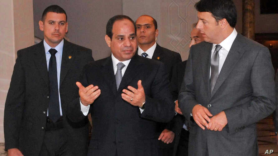 In this photo provided by Egypt's state news agency MENA, Egyptian President Abdel-Fattah el-Sissi, center, escorts Italian Prime Minister Matteo Renzi, right, to a joint press conference, in the presidential palace in Cairo, Aug. 2, 2014