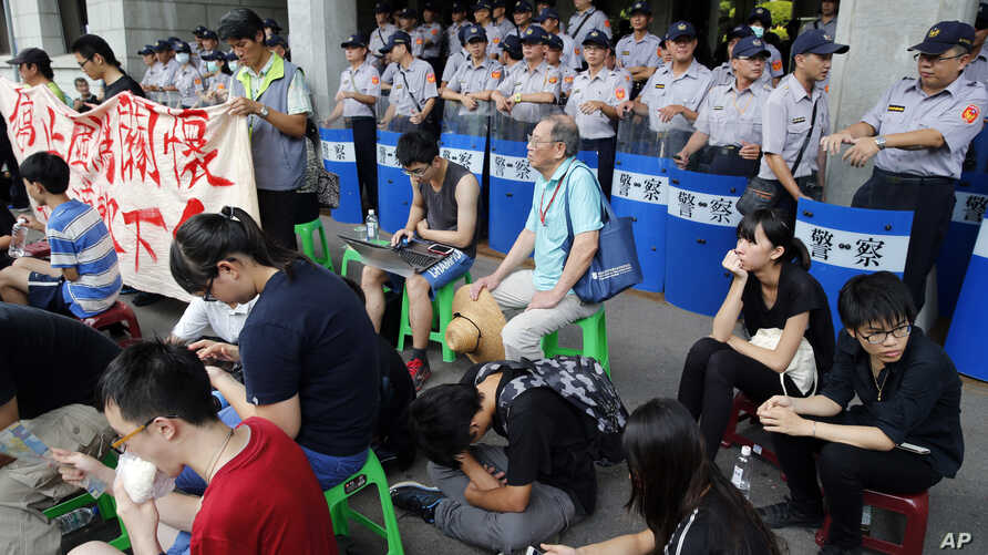 Student protesters against changes to their curriculum occupy the area inside the gates of the Ministry of Education in Taipei, Taiwan, Friday, July 31, 2015.