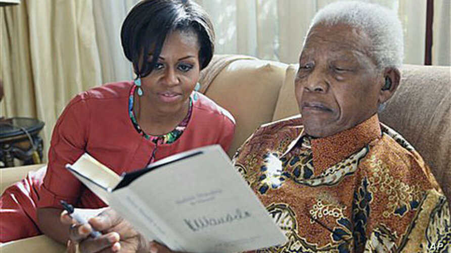 US First Lady Michelle Obama with former South African President Nelson Mandela at this home, in Houghton, South Africa, June 21, 2011. Before becoming president, Mandela was a key ANC leader for many years. (AP Photo/ Debbie Yazbek, Nelson Mandela F