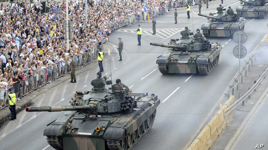 Tanks roll on one of the city's main streets during a yearly military parade celebrating the Polish Army Day in Warsaw, Poland, Aug. 15, 2018.