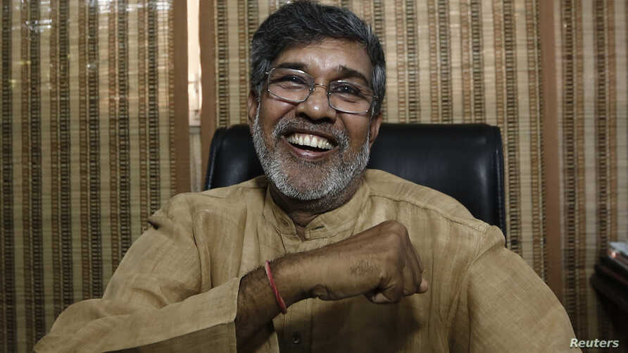 Indian children's right activist Kailash Satyarthi laughs at his office in New Delhi October 10, 2014.
