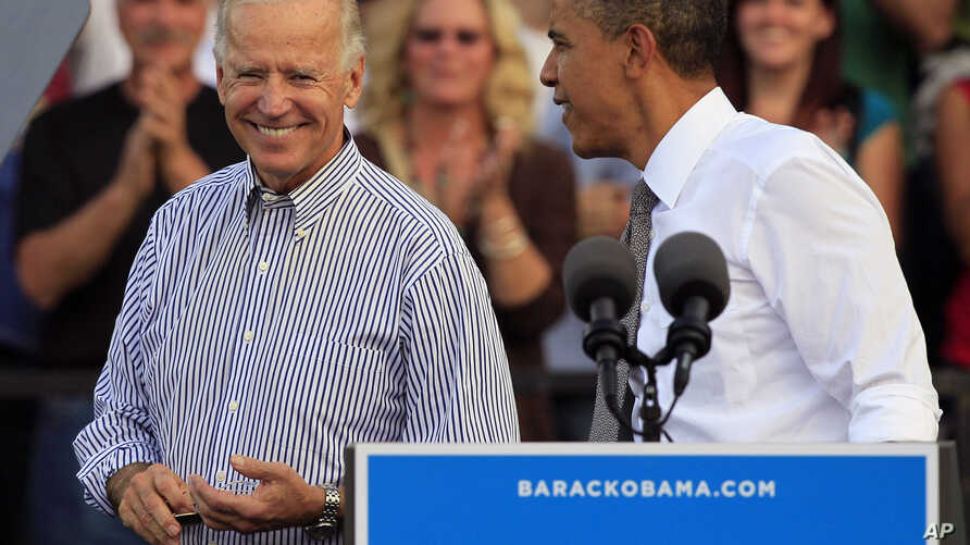 President Barack Obama, right, with Vice President Joe Biden, at campaign rally Oct. 23, 2012, in Dayton, Ohio