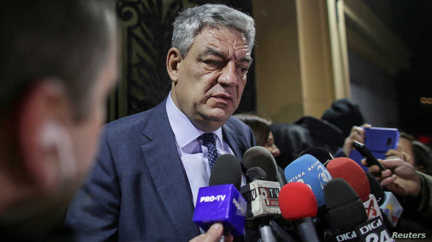 Romania's Prime Minister Mihai Tudose leaves a meeting of the Social Democrat Party (PSD) in Bucharest, Romania, Jan. 15, 2018.
