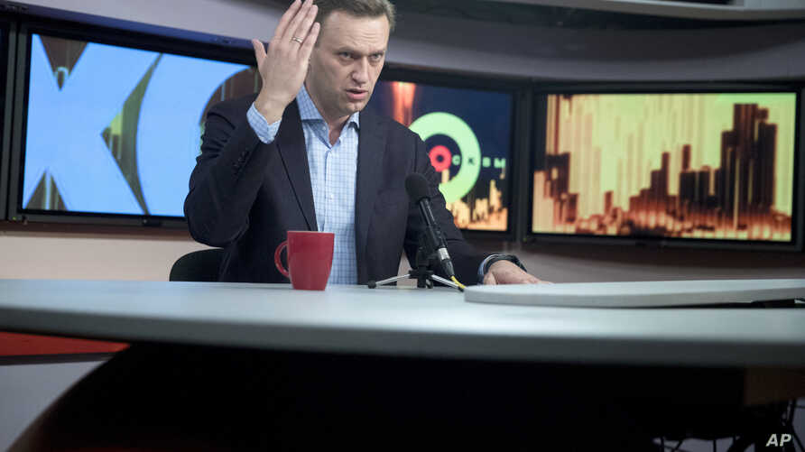 Russian opposition activist Alexei Navalny speaks at the Echo Moskvy (Echo of Moscow) radio station in Moscow, Russia, Wednesday, Dec. 27, 2017.