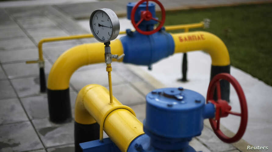 FILE - A pressure gauge, pipes and valves are pictured at a compressor station on the East Poltava gas field near Kovalivka, Poltava region, Ukraine.