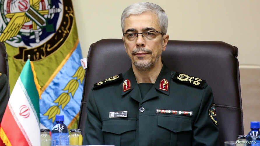 FILE PHOTO: Iranian Military Chief of Staff General Mohammad Baqeri meets with Turkish Chief of Staff General Hulusi Akar (not seen) in Tehran, Iran October 2, 2017.