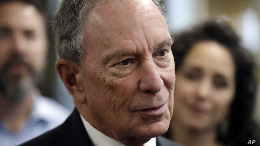 FILE - Potential Democratic presidential candidate Michael Bloomberg speaks to workers during a tour of the WH Bagshaw Company, a pin and precision component manufacturer, in Nashua, N.H., Jan. 29, 2019.