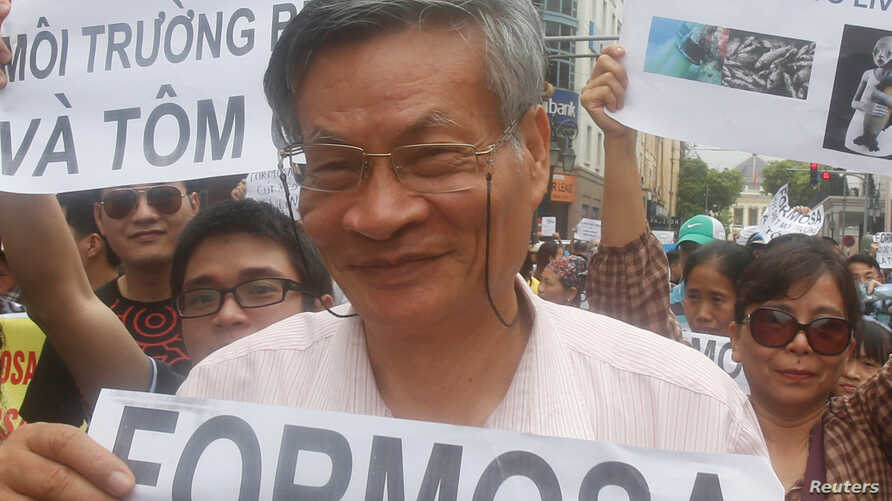 FILE - Nguyen Quang A joins a gather to protest against Taiwanese enterprise Formosa Plastic, says they are demanding cleaner waters in the central regions after mass fish deaths in recent weeks, in Hanoi, Vietnam.