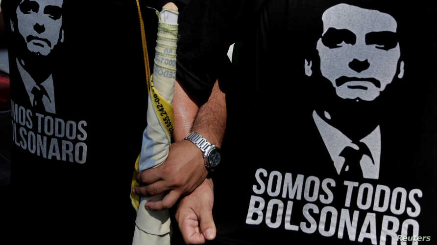 FILE - Supporters of presidential candidate Jair Bolsonaro attend a rally for vice presidential candidate Hamilton Mourao in Manaus, Amazonas state, Brazil, Sept. 15, 2018.
