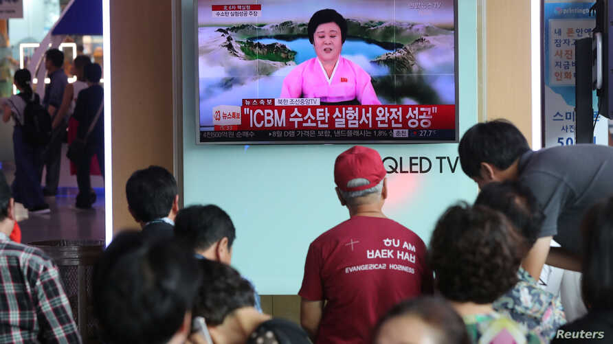 People watch a TV news report about North Korea's  hydrogen bomb test at a railway station in Seoul, South Korea, Sept. 3, 2017.