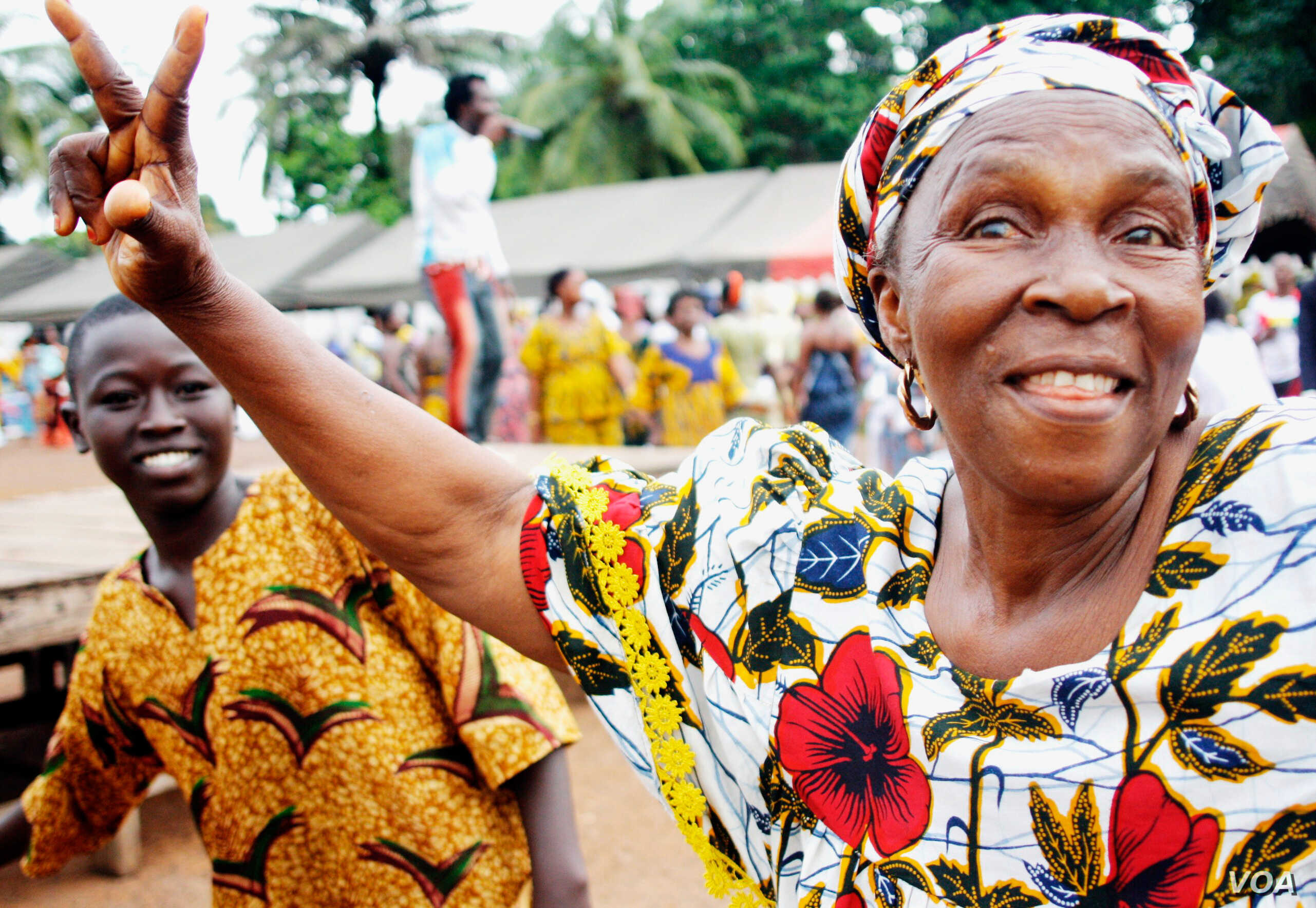A woman at a pro-Alpha Condé rally in the Guinea capital C