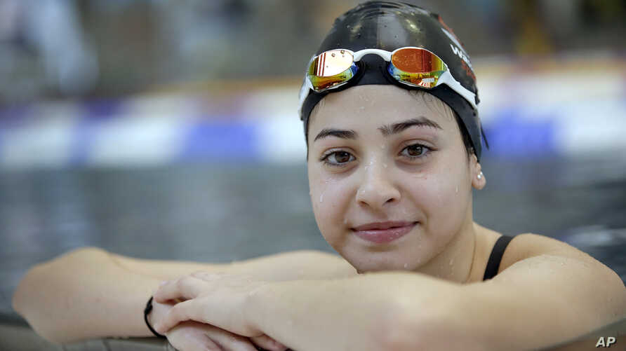 FILE - A Nov. 9, 2015 photo shows Yusra Mardini from Syria posing during a training session in Berlin, Germany. Mardini's family fled war and violence, crossing treacherous seas in small dinghies to live in dusty refugee camps.