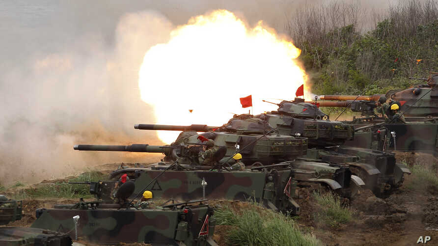 U.S. M60A3 Patton tanks fire at targets during the annual Han Kuang exercises on the outlying Penghu Island, Taiwan, May 25, 2017.