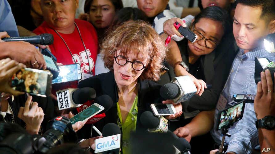 Agnes Callamard, U.N. special rapporteur on extrajudicial executions, talks to the media after her speech at a drug policy forum at University of the Philippines, May 5, 2017 in suburban Quezon city, northeast of Manila, Philippines. Callamard has re