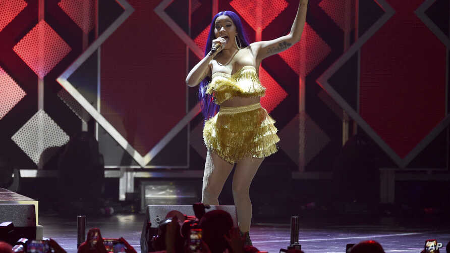 FILE - Cardi B performs at Jingle Ball at The Forum in Inglewood, California, Nov. 30, 2018.