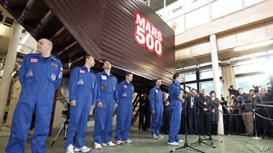 Mars500 experiment crew members talk to journalists after leaving the mock spaceship in Moscow, November 4, 2011