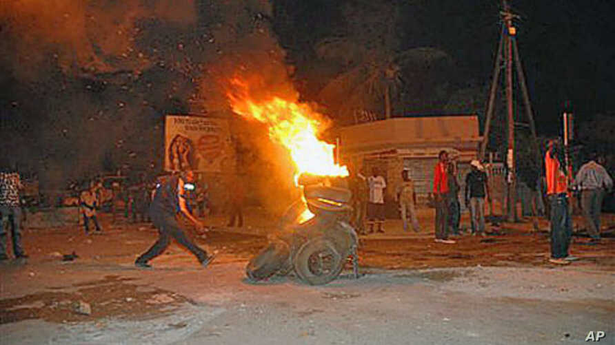 Protesters burn tires in a street after Senegal's highest court ruled that the country's increasingly frail, 85-year-old President Abdoulaye Wade could run for a third term in next month's presidential election, in Dakar, Senegal, January 27, 2012.