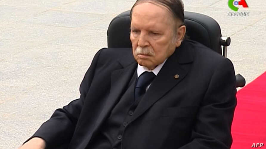 "FILE - A picture from video footage broadcast by Algeria's ""Canal Algerie"" on July 5, 2016 shows wheelchair-bound President Abdelaziz Bouteflika visiting El-Alia cemetery where independence fighters are buried in an eastern Algiers suburb."