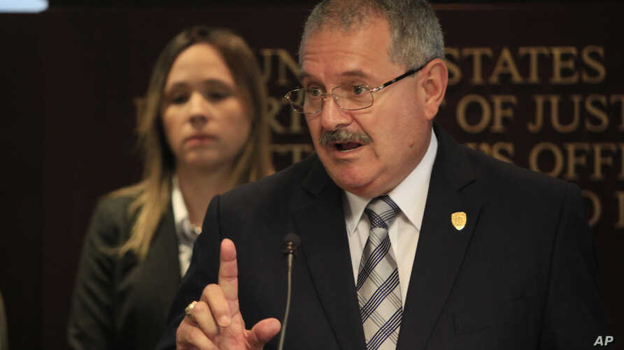 Puerto Rico Police Superintendent, Jose Caldero speaks during a news conference about charges filed against 10 Puerto Rico police officers at the United States Attorney's Office in San Juan, Puerto Rico, Sept. 29, 2015.