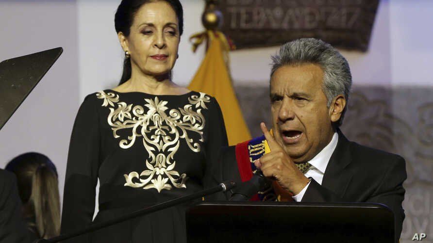 Ecuador's President Lenin Moreno gives a speech, as his wife Rocio Gonzalez listens to him, from government palace balcony in Quito, Ecuador, May 24, 2017.