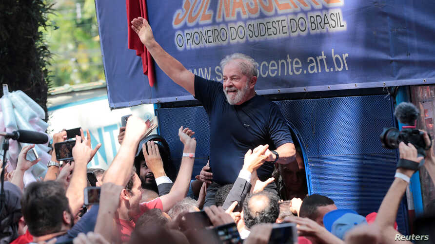 FILE - Former Brazilian President Luiz Inacio Lula da Silva is carried by supporters in front of the metallurgic trade union in Sao Bernardo do Campo, Brazil, April 7, 2018.