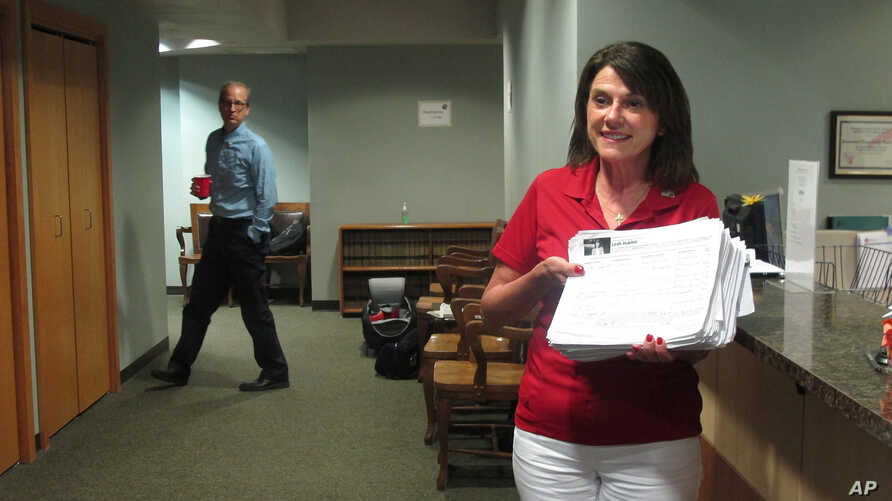 Republican U.S. Senate candidate Leah Vukmir submits nomination papers with Wisconsin elections officials in Madison, Wisconsin, May 30, 2018.