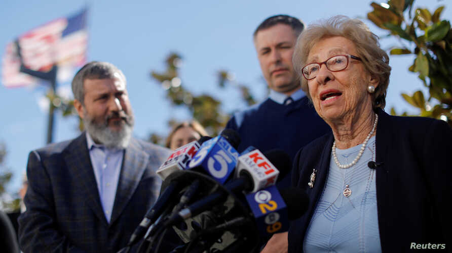 Auschwitz survivor Eva Schloss, stepsister of Holocaust diarist Anne Frank, talks to the media at Newport Harbor High School, March 7, 2019, after speaking with a group of students seen in viral online photos giving Nazi salutes over a swastika that