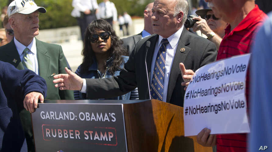 Rep. Steve King, R-Iowa, speaks to a small group of demonstrators opposed to President Obama's immigration reform, outside the Supreme Court in Washington, April 18, 2016.